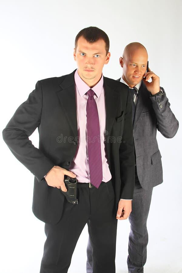 La guardia del corpo dell'uomo d'affari fotografia stock