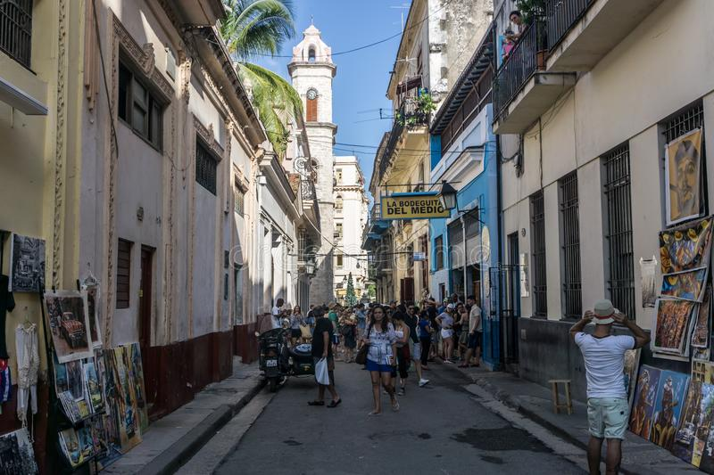 Street view with tourists in front of La Bodega de Medio, most famous bar in Cuba, general travel imagery from La Havana, Cuba stock photography