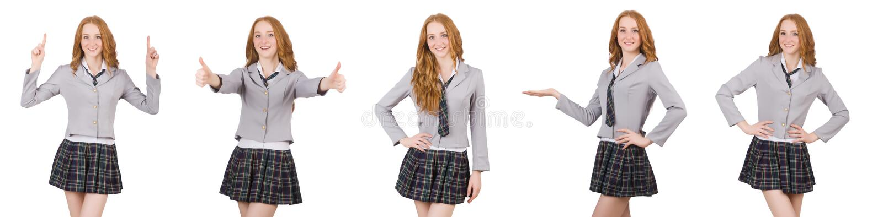 La hembra joven del estudiante del pelirrojo aislada en blanco fotos de archivo libres de regalías