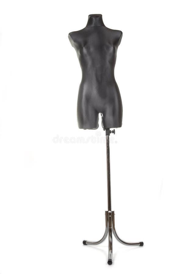 La hembra negra adapta el maniquí simulado con el soporte foto de archivo libre de regalías