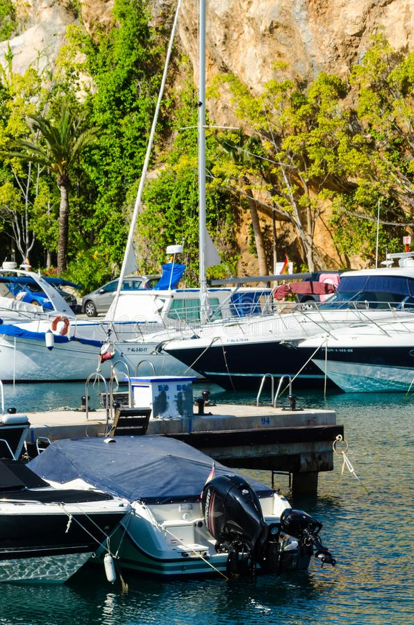 LA HERRADURA, SPAIN - MAY 26, 2018 Luxury boats and apartments. LA HERRADURA, SPAIN - MAY 26, 2018 A beautiful marina with luxury yachts and motor boats in the stock image