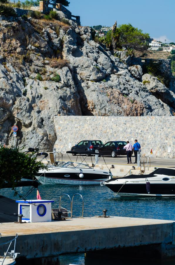 LA HERRADURA, SPAIN - MAY 26, 2018 Luxury boats and apartments. LA HERRADURA, SPAIN - MAY 26, 2018 A beautiful marina with luxury yachts and motor boats in the stock photo