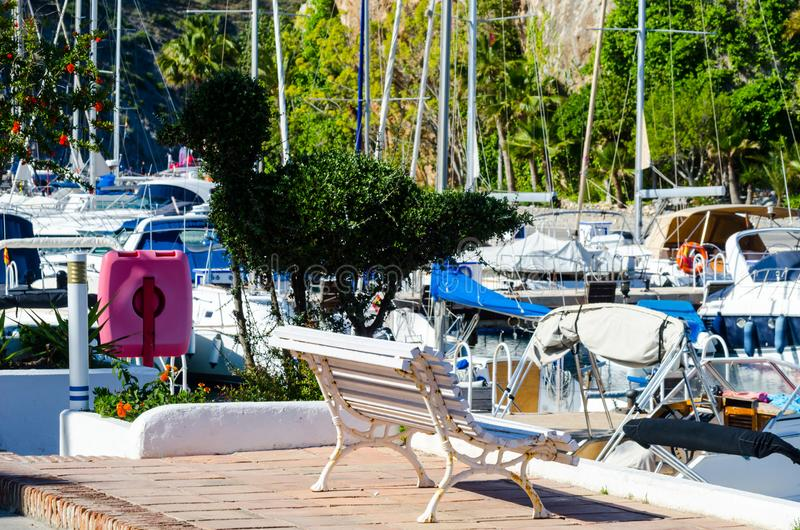LA HERRADURA, SPAIN - MAY 26, 2018 Luxury boats and apartments. LA HERRADURA, SPAIN - MAY 26, 2018 A beautiful marina with luxury yachts and motor boats in the stock photography
