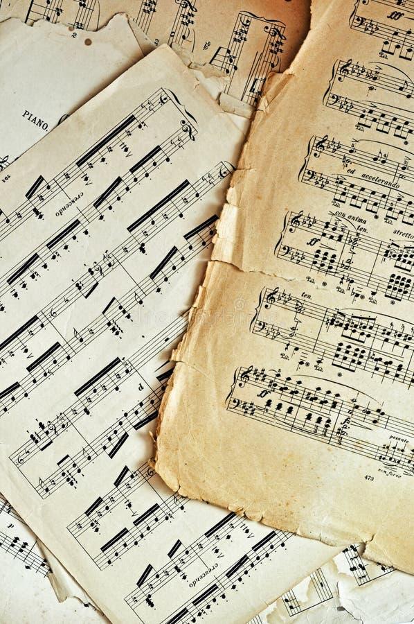 La hoja de música vieja pagina el fondo foto de archivo libre de regalías