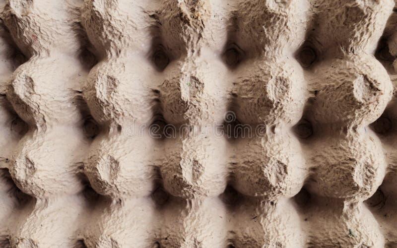 La hoja de superficie de la visi?n superior del caj?n vac?o del huevo de la cartulina o los huevos encuadierna la caja hecha del  imagen de archivo