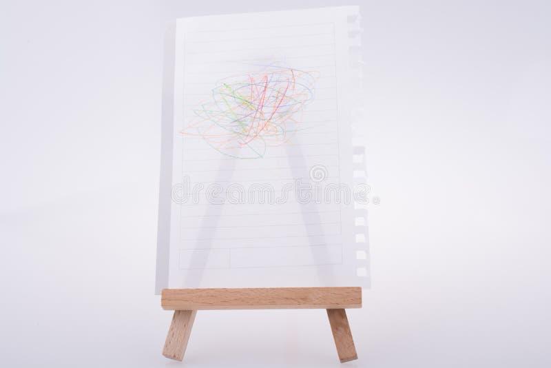 La hoja del Libro Blanco garabateó puesto el trípode para pintar ilustración del vector