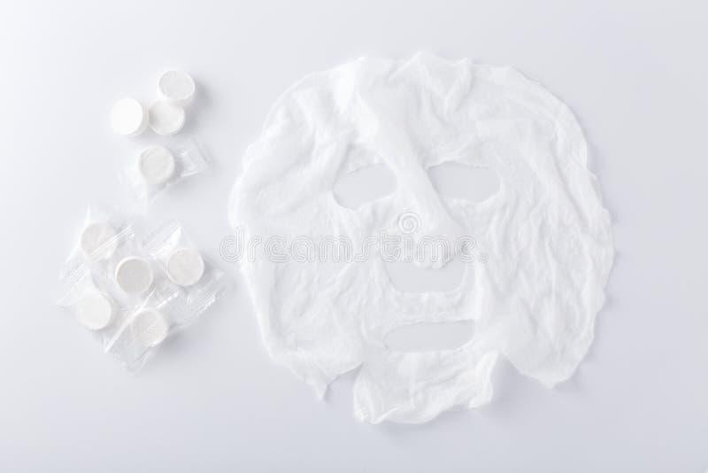 La hoja facial de la máscara comprimió fotografía de archivo libre de regalías