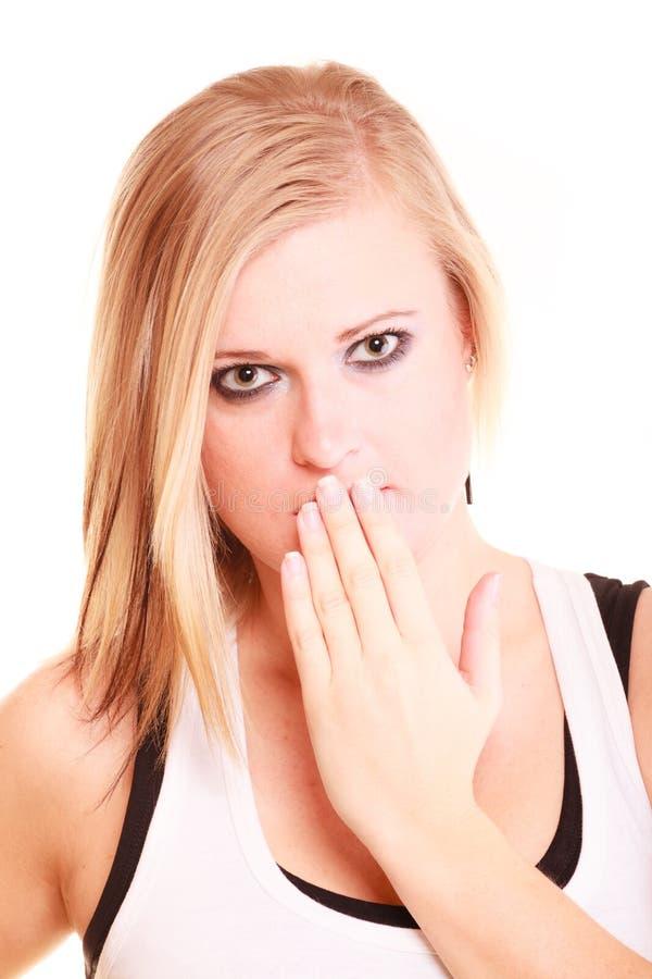 La imagen de la mujer sorprendente con entrega la boca foto de archivo libre de regalías