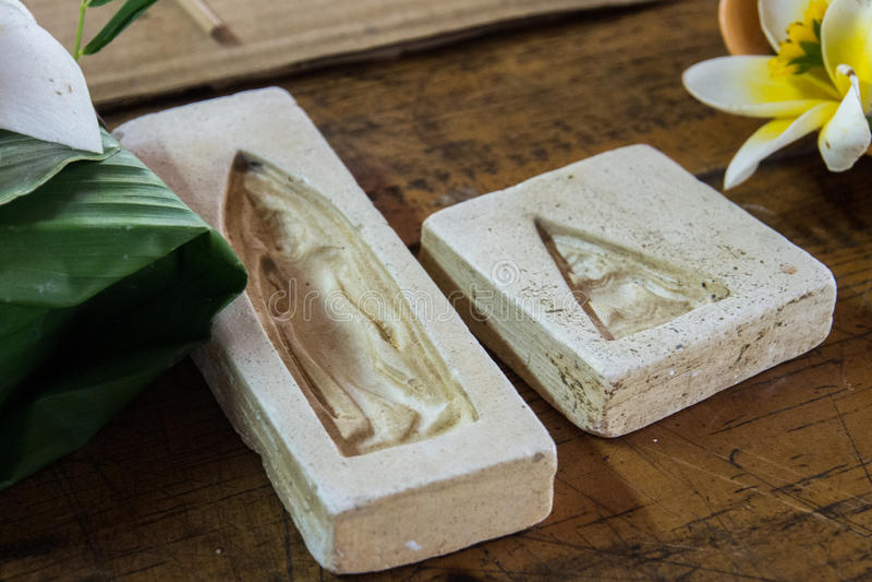 La impresión del pequeño medallón de Buda imagenes de archivo