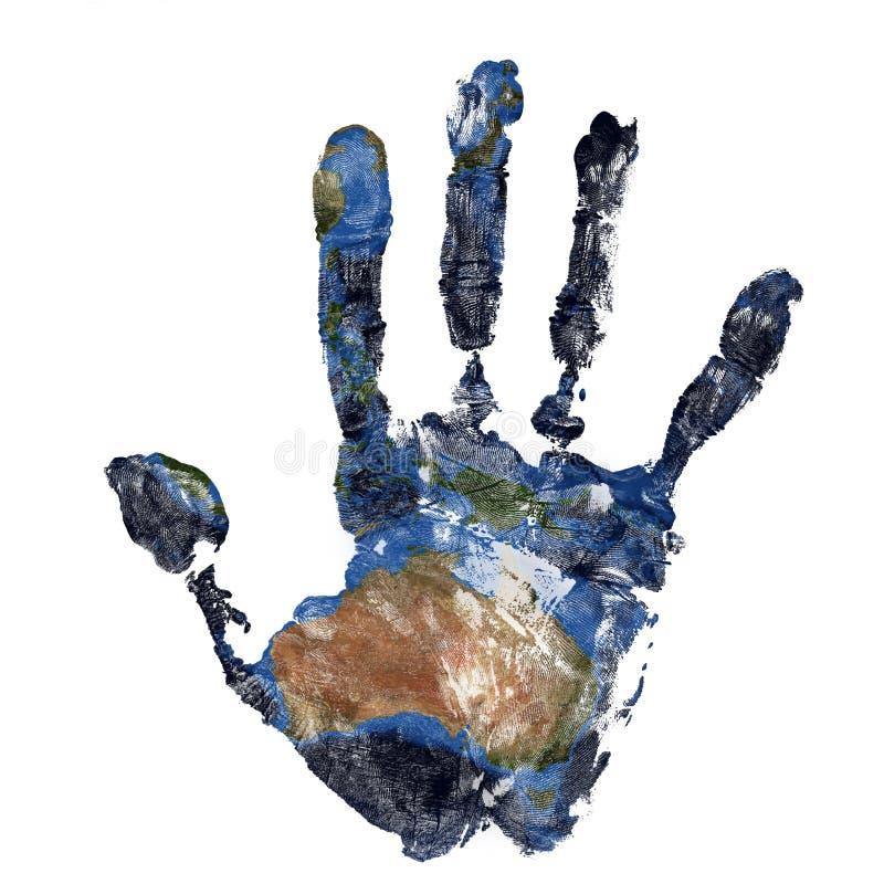 La impresión real de la mano combinó con un mapa de Australia de nuestra tierra azul del planeta Elementos de esta imagen equipad fotografía de archivo libre de regalías