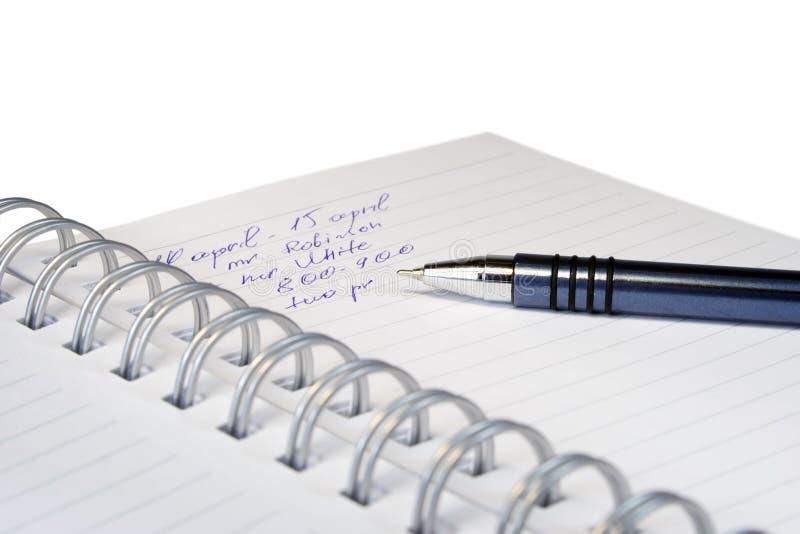 La información en un cuaderno. foto de archivo