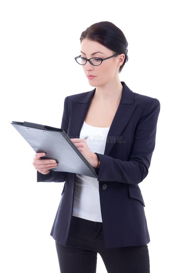 La jeune écriture attrayante de femme d'affaires sur le presse-papiers a isolé o photos stock