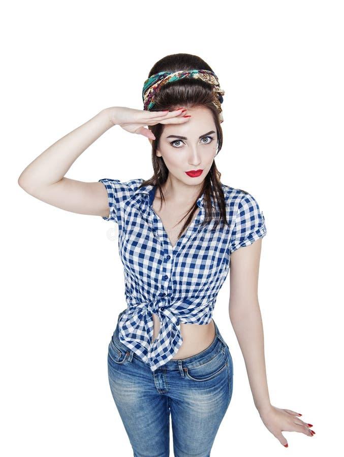 La jeune belle femme dans la rétro goupille vers le haut du style a salué d'isolement photographie stock libre de droits