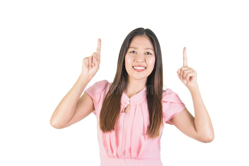 La jeune femme asiatique de sourire avec des doigts se dirigent  photographie stock libre de droits