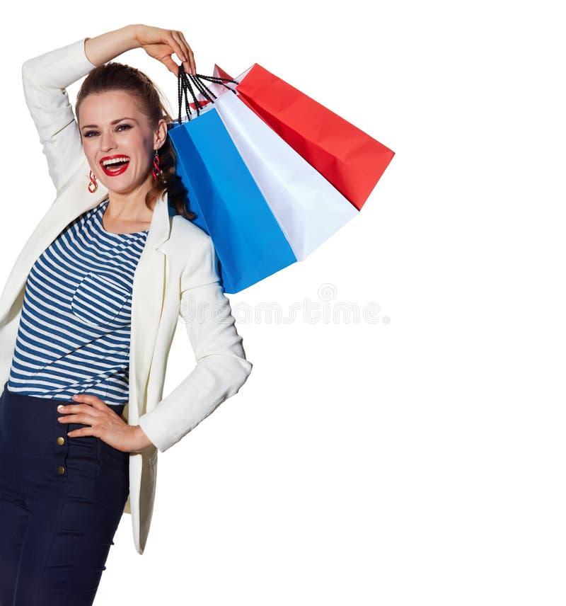 La jeune femme heureuse avec le drapeau français colore des paniers photographie stock libre de droits
