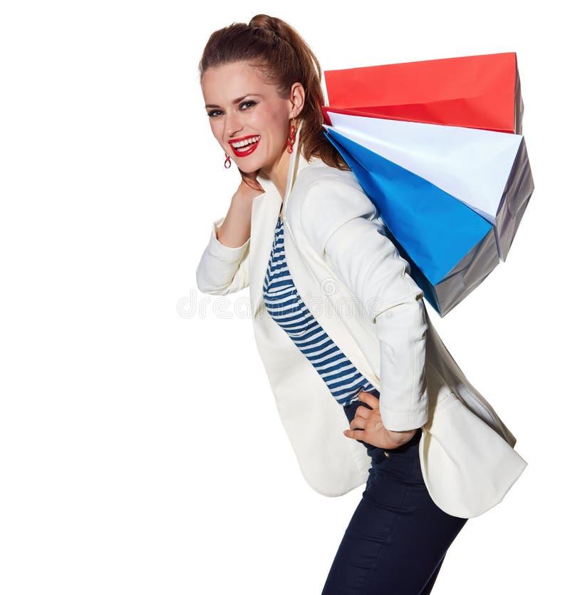 La jeune femme heureuse avec le drapeau français colore des paniers image libre de droits