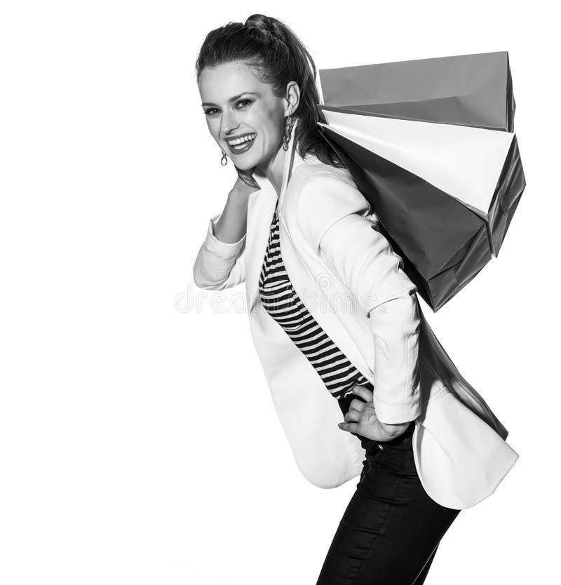 La jeune femme heureuse avec le drapeau français colore des paniers images libres de droits