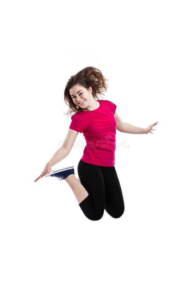 La jeune femme sautant sur le fond blanc photo stock