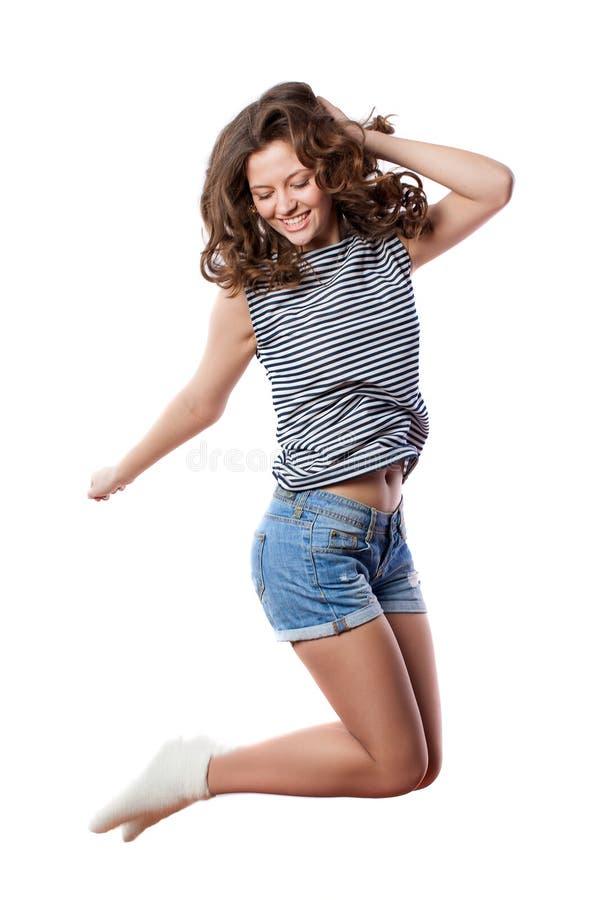 La jeune femme saute photos stock