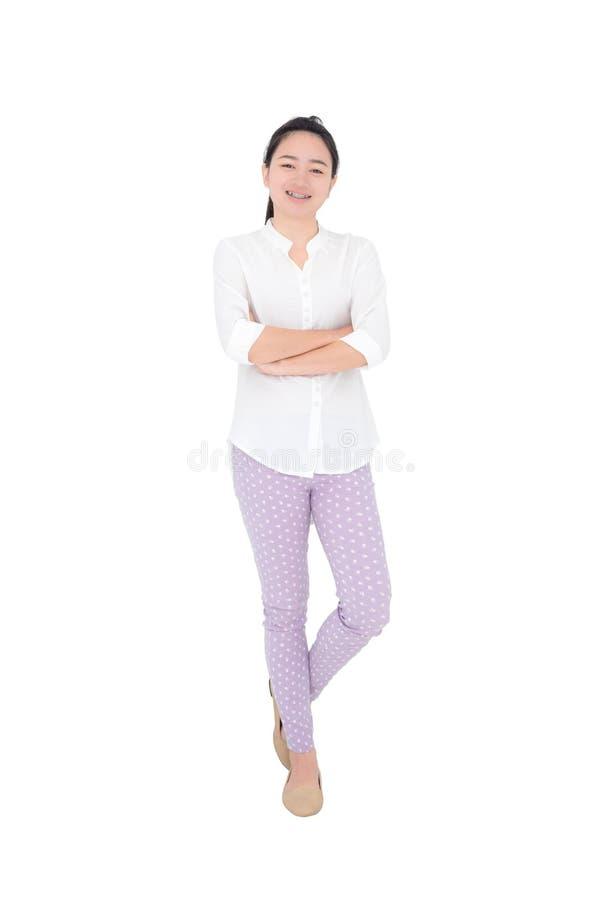 La jeune femme sourit au-dessus du blanc photographie stock libre de droits