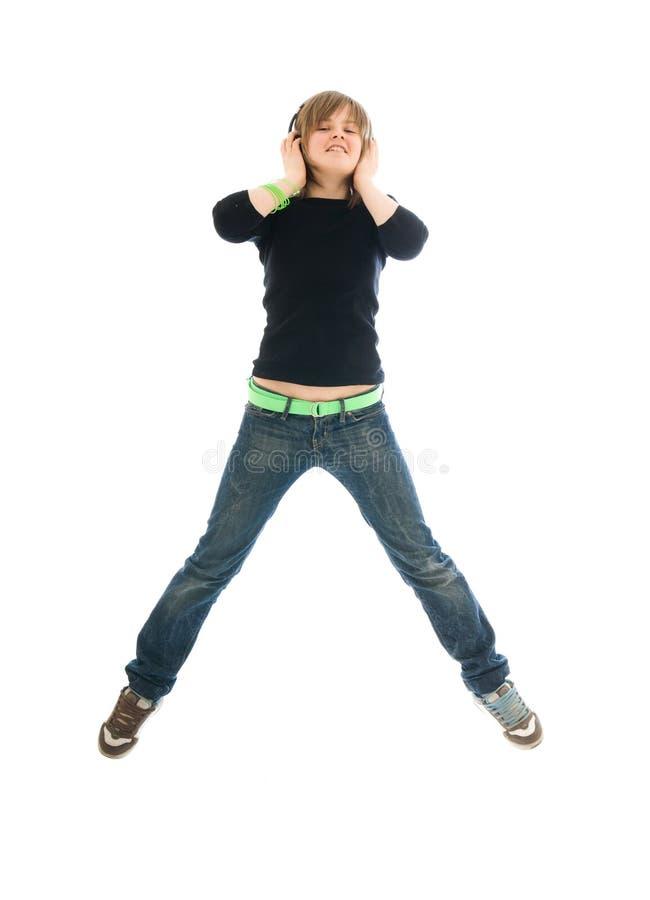 La jeune fille avec écouteurs d'isolement photo libre de droits
