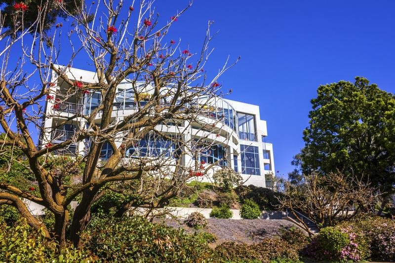 La Jolla, California, USA - April 4, 2017: Campus of the University of California San Diego. Naked coral tree blossom in the front. La Jolla, California, USA stock photography