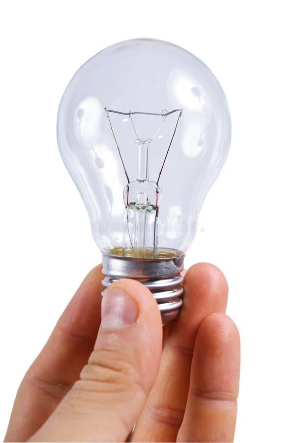 La lámpara del bulbo adentro sirve las manos imagen de archivo libre de regalías