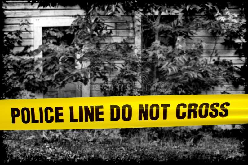 La línea de policía no cruza la cinta en la casa de la escena del crimen fotografía de archivo libre de regalías