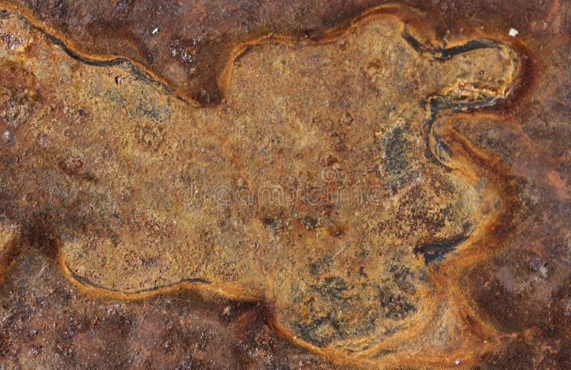 La lamina di metallo ha corroso la struttura significativa ossidata arrugginita del fondo fotografie stock