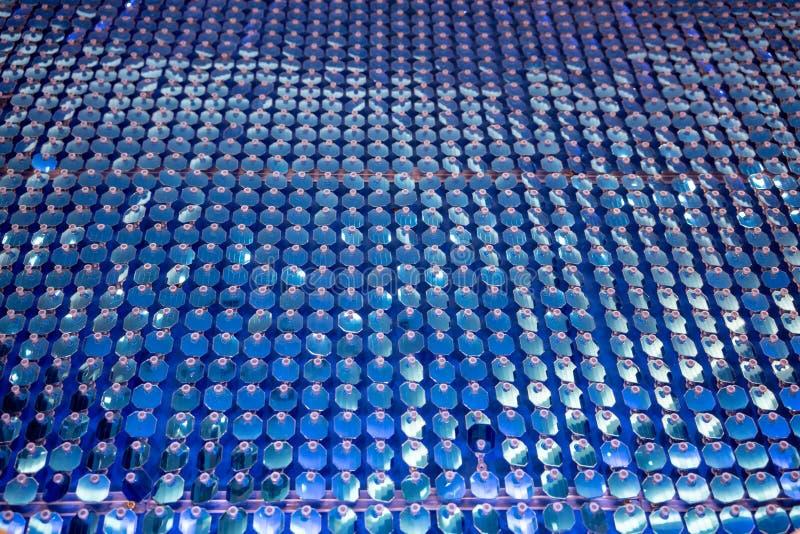 La lentejuela azul brillante que brilla empareda la decoración para la textura y el CCB fotografía de archivo