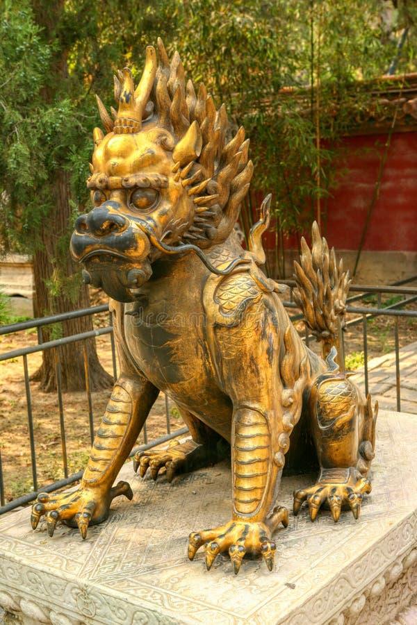 La licorne dorée se reposent dans le jardin impérial du Cité interdite Pékin photographie stock libre de droits