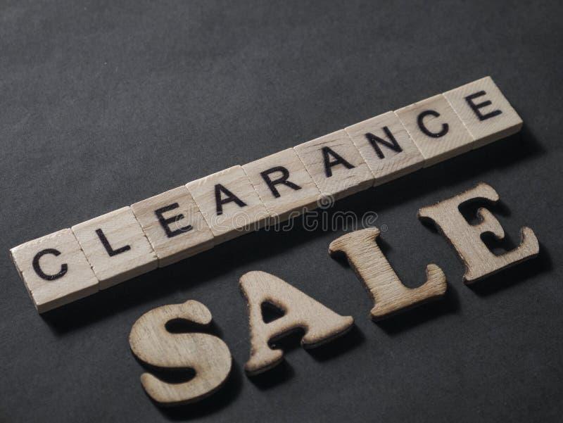 La liquidaci?n, las palabras de comercializaci?n de motivaci?n del negocio cita concepto foto de archivo libre de regalías
