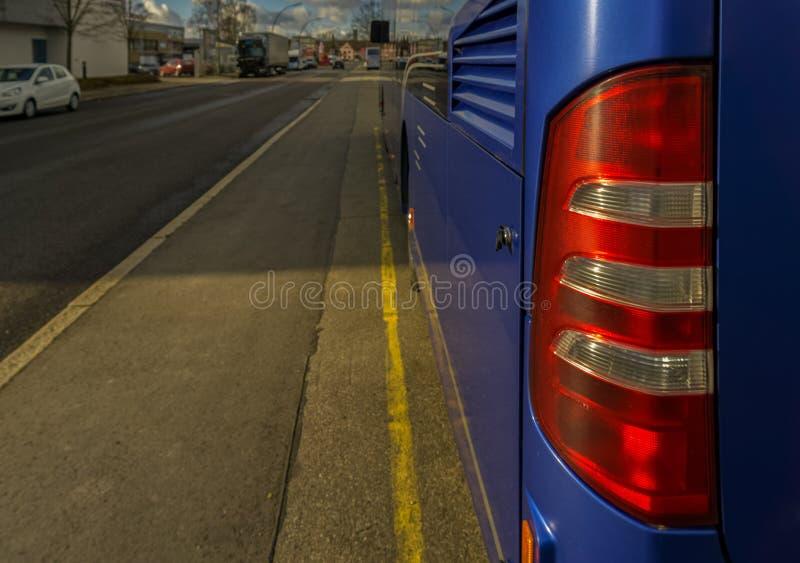 La luce posteriore di un bus fotografia stock