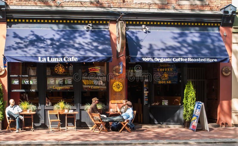 La Luna Cafe on Water Street in Gastown, Vancouver. Customers relaxing on the pavement terrace of the La Luna Cafe on Water Street in Gastown, Vancouver stock photos