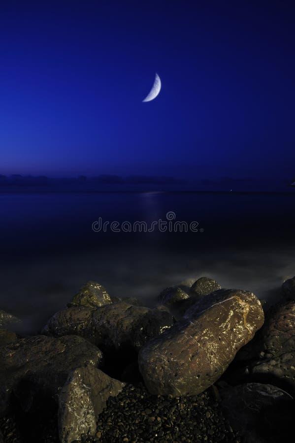 La luna y el mar foto de archivo