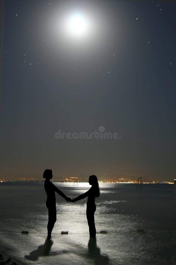 La lune et le femme. photographie stock