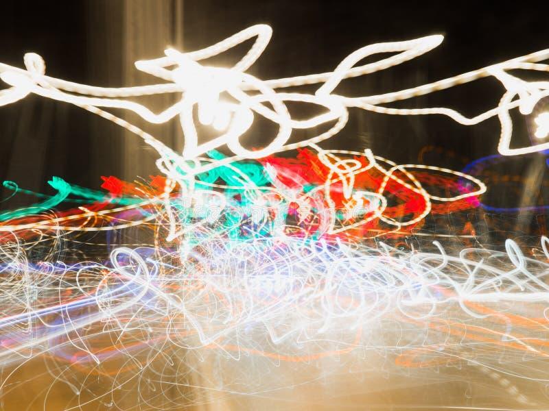 La luz abstracta mágica se arrastra en el movimiento al azar - backgrou abstracto foto de archivo libre de regalías