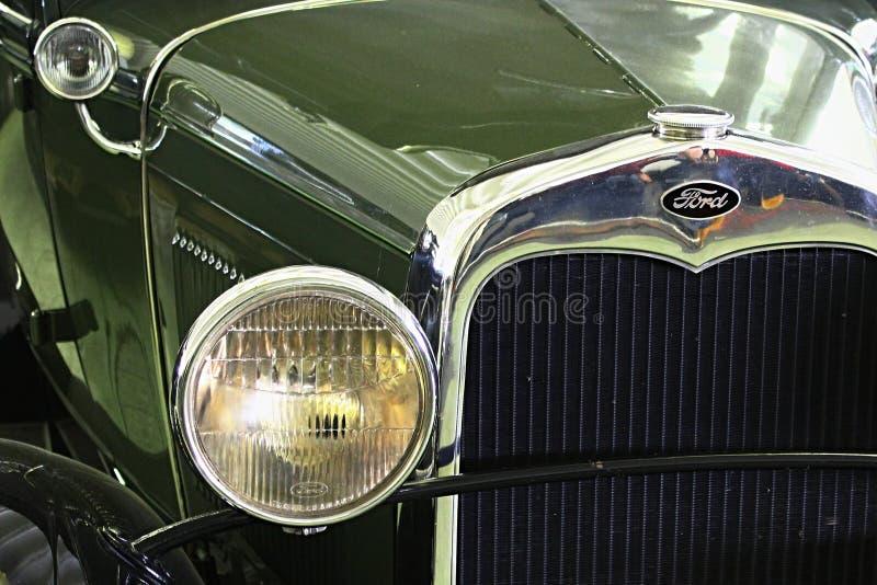 La máscara de Fron y la luz de la cabeza del coche del veterano del vintage vadean un Murray con fecha de 1930 imagenes de archivo
