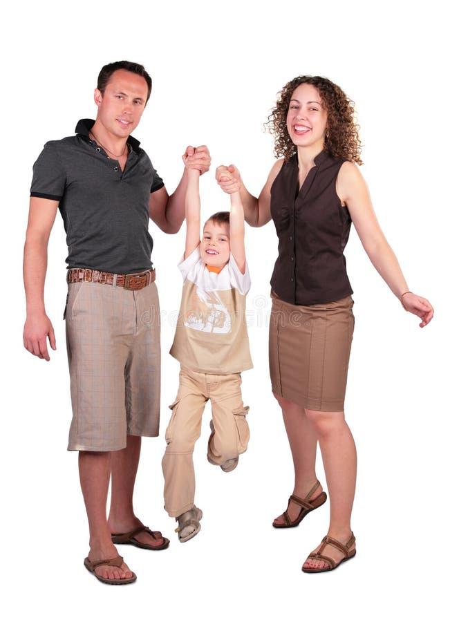 La mère avec le père ont soulevé le fils photographie stock libre de droits
