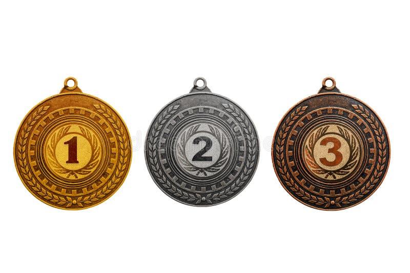 La médaille attribuant l'or, argent, se bronzent d'isolement sur le fond blanc photos libres de droits