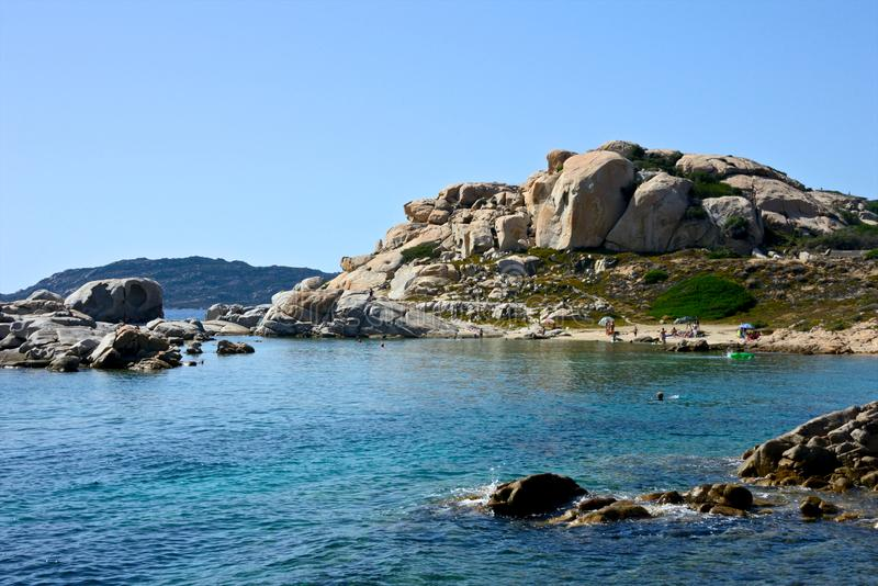 La Maddalena seascape with a beach and blue sea, rock formation royalty free stock images