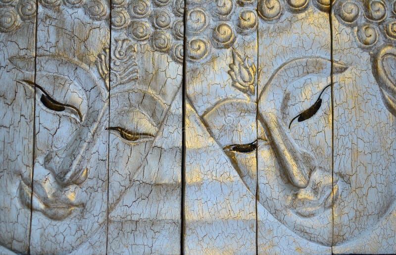 La madera de talla de la cara de Buddha imágenes de archivo libres de regalías