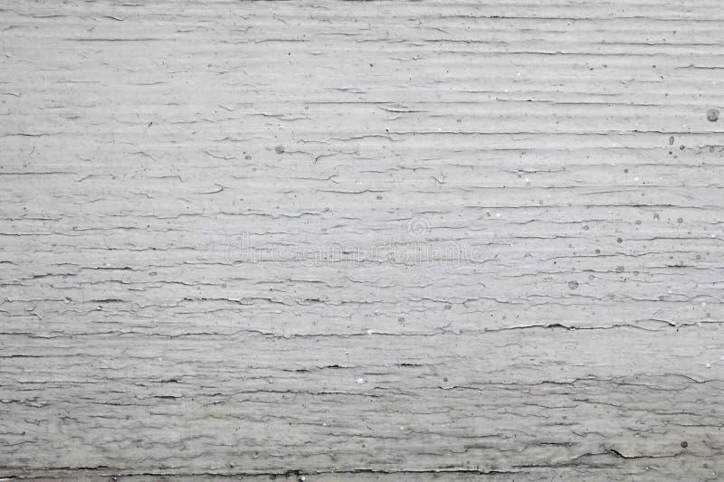 La madera vieja cubierta con blanco agrietó textura de la pintura fotografía de archivo
