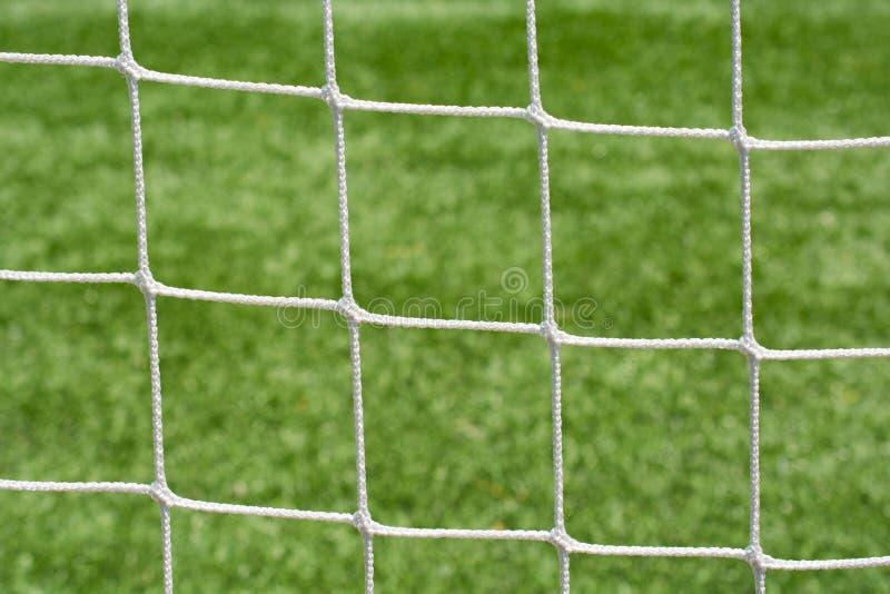 La maglia netta di calcio mette insieme il primo piano fotografie stock