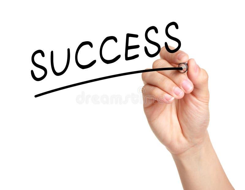 La main écrivent un mot de succès image stock