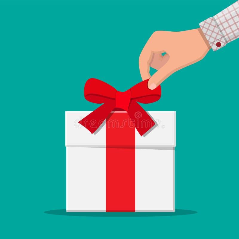 La main délie l'arc de ruban sur le boîte-cadeau blanc illustration de vecteur
