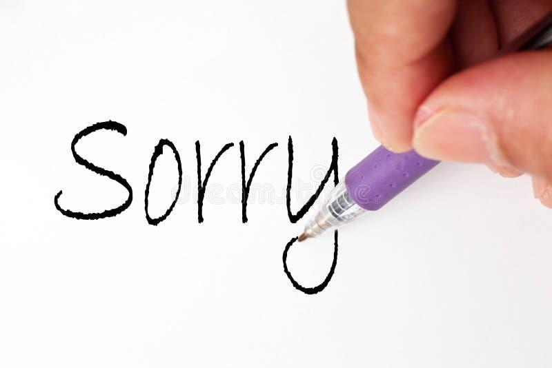 La main désolée écrivent photo libre de droits