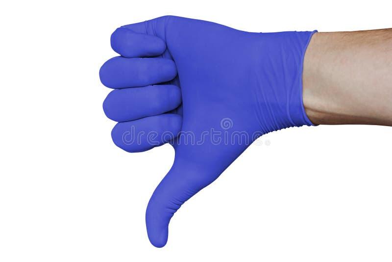 La main dans le gant médical bleu montrant la désapprobation manie maladroitement en bas du signe d'isolement sur le fond blanc photos libres de droits