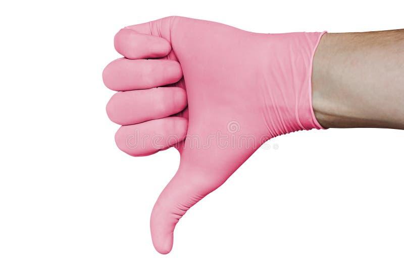 La main dans le gant médical rose montrant la désapprobation manie maladroitement en bas du signe d'isolement sur le fond blanc images libres de droits