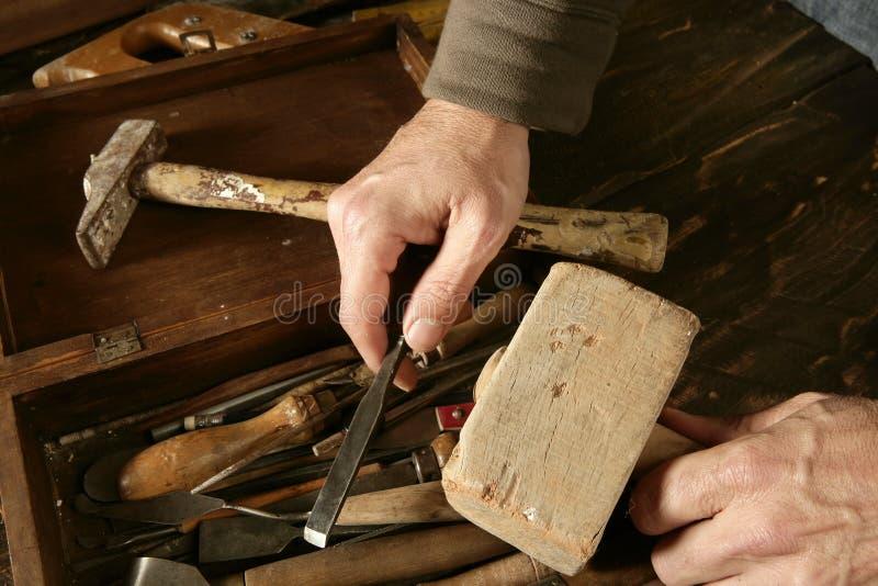 La main de charpentier de Craftman usine l'artiste images stock